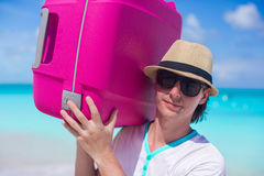 Close-up of a young man carrying his luggage Royalty Free Stock Photo