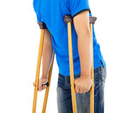 Close up of young man on crutches. Stock Photo