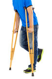 Close up of young man on crutches. Royalty Free Stock Photography