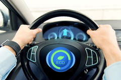 Close up of young man driving car in eco mode Stock Photo