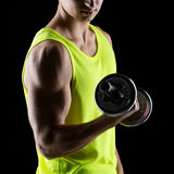 Close up of young man with dumbbell Stock Photos