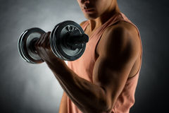 Close up of young man with dumbbell Stock Photo