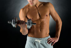 Close up of young man with dumbbell Royalty Free Stock Photography