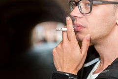 Close up of young man enjoying a smoke Stock Photos