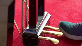 Close up young man feet playing on piano pedals.