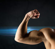 Close up of young man flexing and showing biceps Stock Photo
