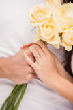 Close up of young man giving girlfriend white roses Royalty Free Stock Photo