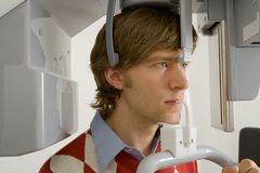Close-up of a young man going through a medical dental scan Stock Images