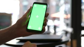 Close-Up Of Man Hand Using Mobile Phone With Green Screen In Restaurant stock footage