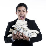 Close up the young man happy and carrying a large pile of bankno Stock Image