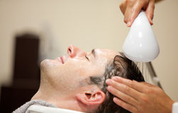 Close-up of a young man having his hair washed Stock Photography