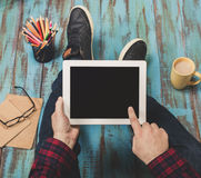 Close up young man holding white tablet with copy space Stock Photos