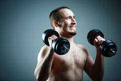 Close up of young man lifting weights Royalty Free Stock Images