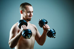 Close up of young man lifting weights Royalty Free Stock Photo
