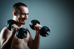 Close up of young man lifting weights Royalty Free Stock Photography