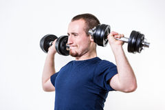 Close up of young man lifting weights Stock Images