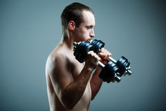 Close up of young man lifting weights Royalty Free Stock Image