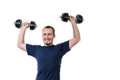 Close up of young man lifting weights Royalty Free Stock Photos