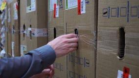 Closeup young man looking for box at store warehouse shelf 4k. Close up young man looking for box at store warehouse shelf 4k stock video