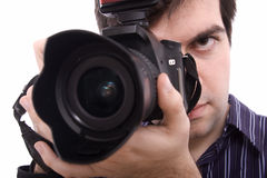 Close up of a young man photographing Stock Photos