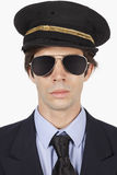 Close-up of young man in pilot uniform against white background Stock Photography
