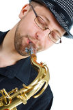 Close-up of young man playing saxophone Royalty Free Stock Images