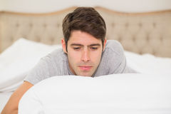 Close up of a young man resting in bed Stock Images