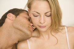 Close-up of a young man romancing with a young woman Stock Images