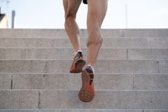 Close up of young man running up the stairs with running clothes stock photography