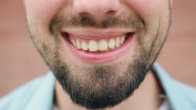 Close-up of a Man`s Mouth Smiling stock photography