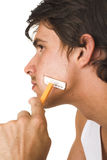 Close up of young man shaving Stock Images
