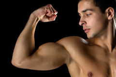 Close up of young man showing biceps Stock Photos
