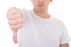 Close up of young man showing thumbs down isolated on white Stock Photography