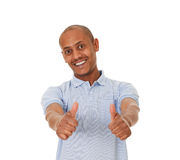 Close-up of a young man showing thumbs up. Stock Photos