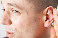 Close Up Of Young Man Suffering With Hearing Difficulties Royalty Free Stock Photography
