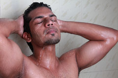 Close-up of a young man taking a shower Royalty Free Stock Image