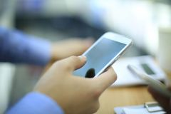 Close up of a young man using mobile smart phone. Close up of a man using mobile smart phone Stock Images