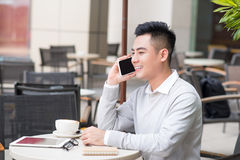 Close up of Young Man using telephone look out the window. or Business man Contact Customer. Royalty Free Stock Images