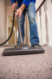 Close up a young man vacuuming Royalty Free Stock Photos