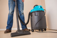 Close up a young man vacuuming Royalty Free Stock Images