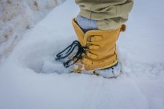 Close up of young man wearing leather hiking boots in legs and mountain in Norway.  Stock Photo