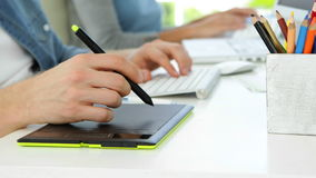Close up of young man working at his desk. In the office stock footage