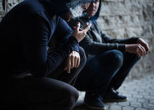 Close up of young men smoking cigarettes Royalty Free Stock Image