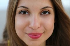 Close up of young model face smiling at camera. Very close up of mixed race model. stock images