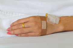 Close up of young patient hand recovering in hospital Royalty Free Stock Images