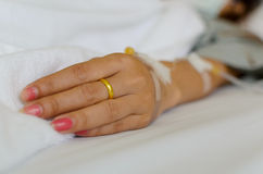 Close up of young patient hand recovering in hospital Stock Photo