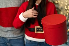 Close up of young people in sweaters holding gifts stock photography