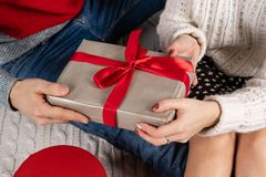 Close up of young people in sweaters holding gifts royalty free stock photos