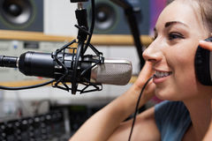 Close up of a young radio host speaking. Through a microphone royalty free stock photos