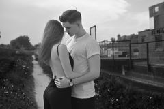 Close-up of young romantic couple is kissing and enjoying the company of each other in black and white. Young couple in love royalty free stock photos